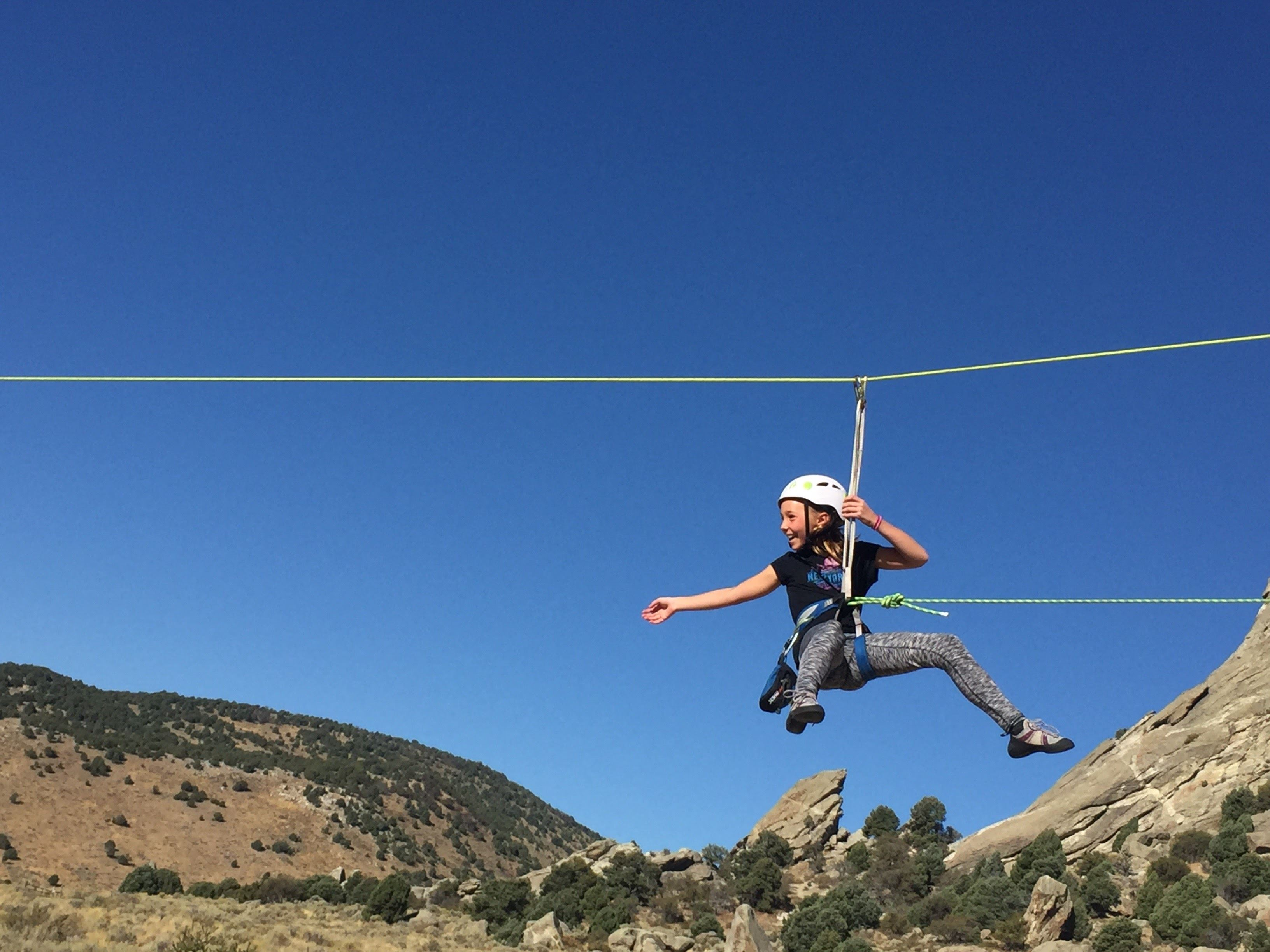Girl zip lining in the mountains at Sun Valley Community School
