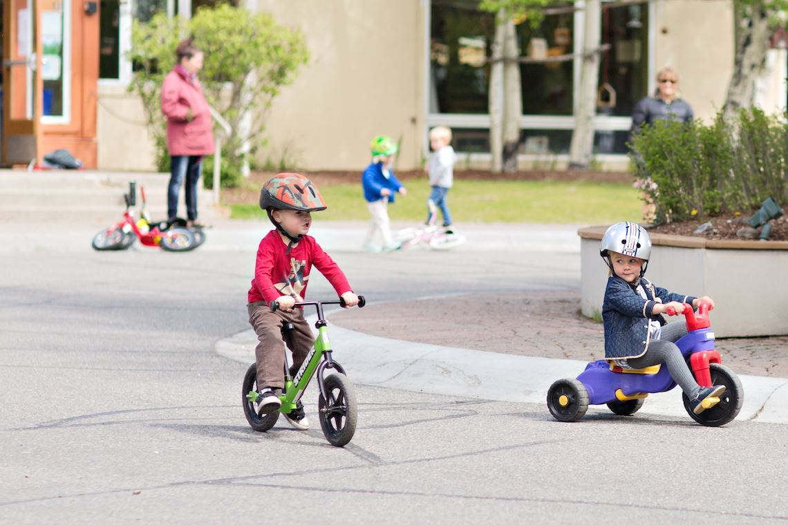 Preschoolers riding bicycles and tricycles in the private preschool program in Sun Valley