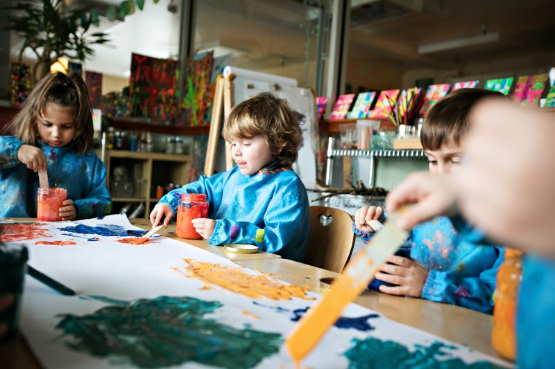 Preschoolers painting in class in Sun Valley private preschool programs