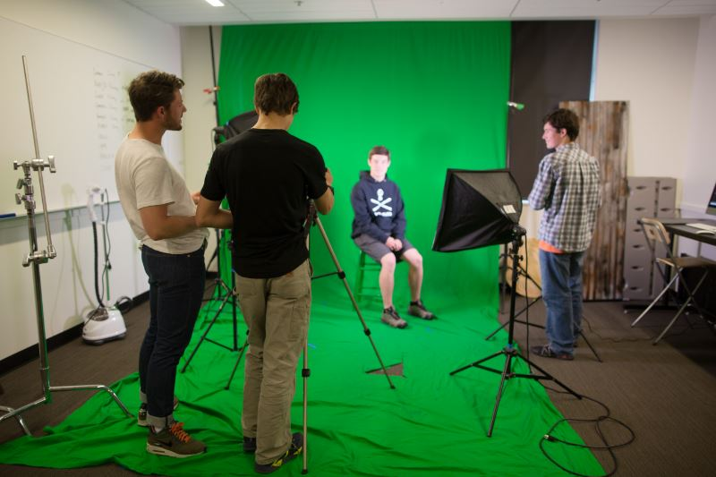 Students at a green screen filming session