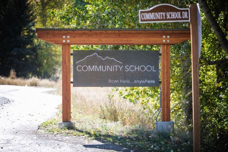 A Community School sign posted on Community School Drive