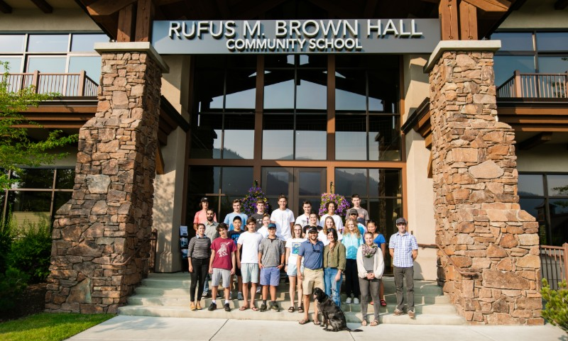 A group of students standing in front of Rufus M. Brown Hall
