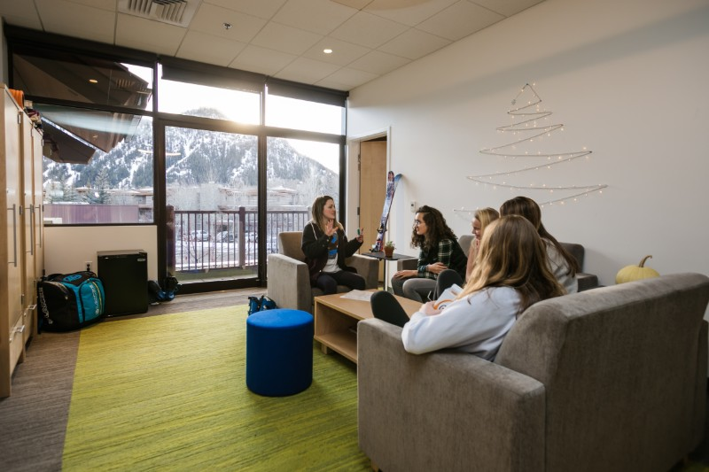 A group of students sitting in a student suite