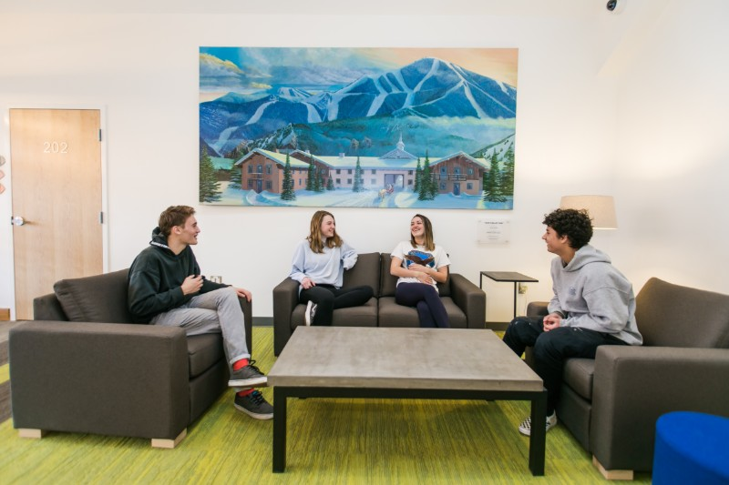 Four students sitting in the residential student lounge