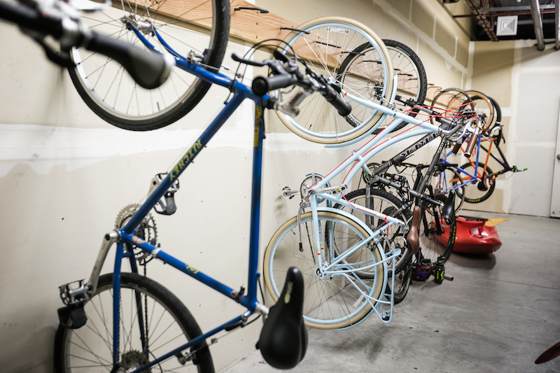 Bikes hanging on a wall in a storage facility