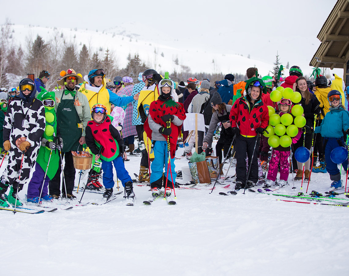 group of ski students in costumes at a ski lodge