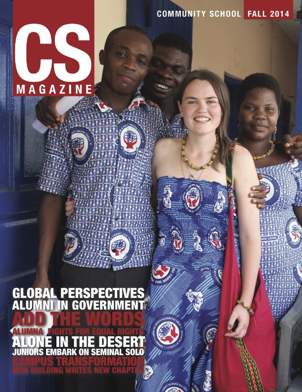 CS magazine of a group of people in a hall