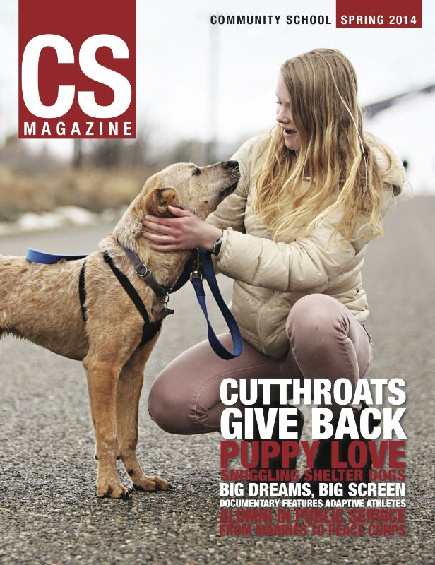 CS magazine of a girl kneeling with a dog