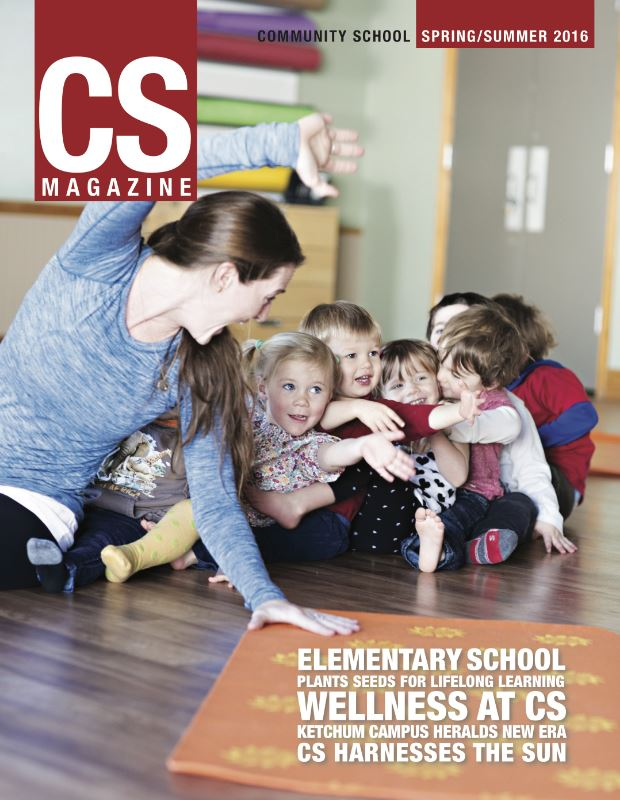 CS magazine of a woman with children at an elementary school