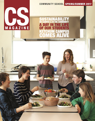 CS magazine cover of a group of people eating at a table in a kitchen