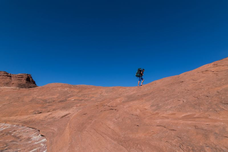 A person hiking on a red mountain