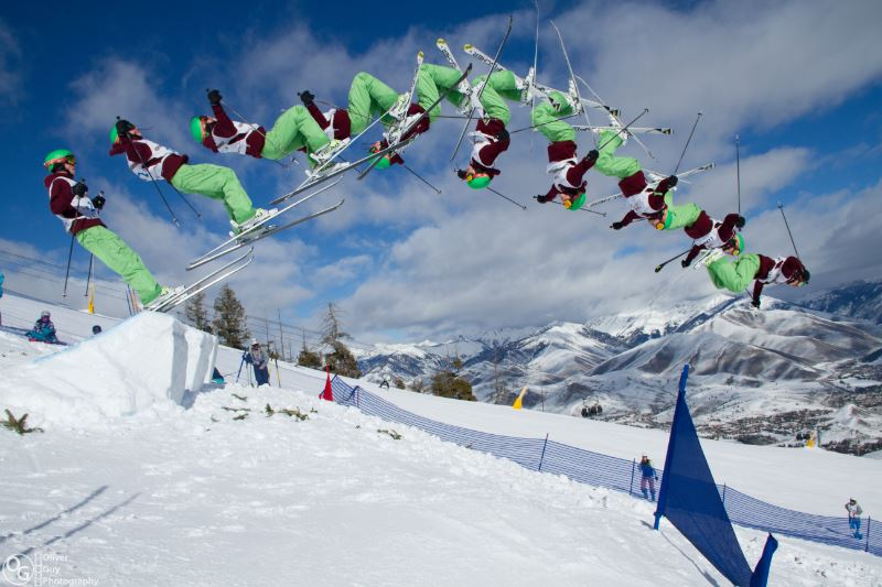 A skier performing a backflip on a ski slope