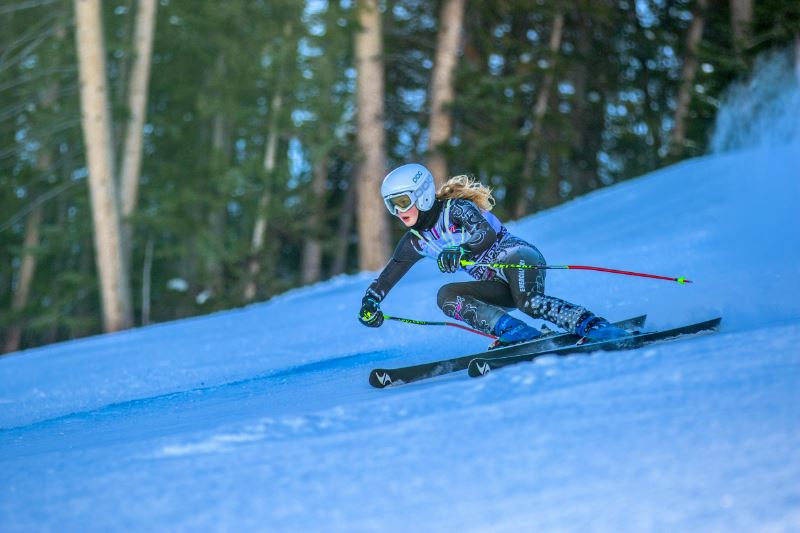 A downhill skier on a ski slope