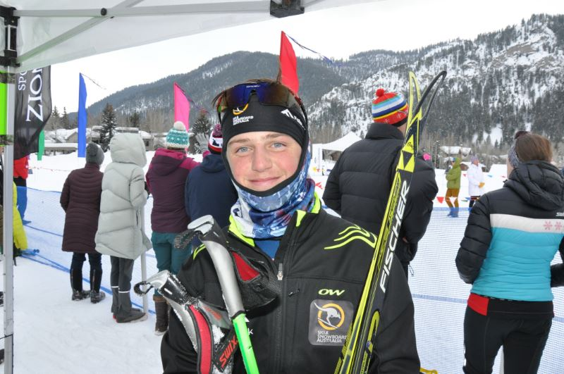 A student in ski gear in front of a ski event
