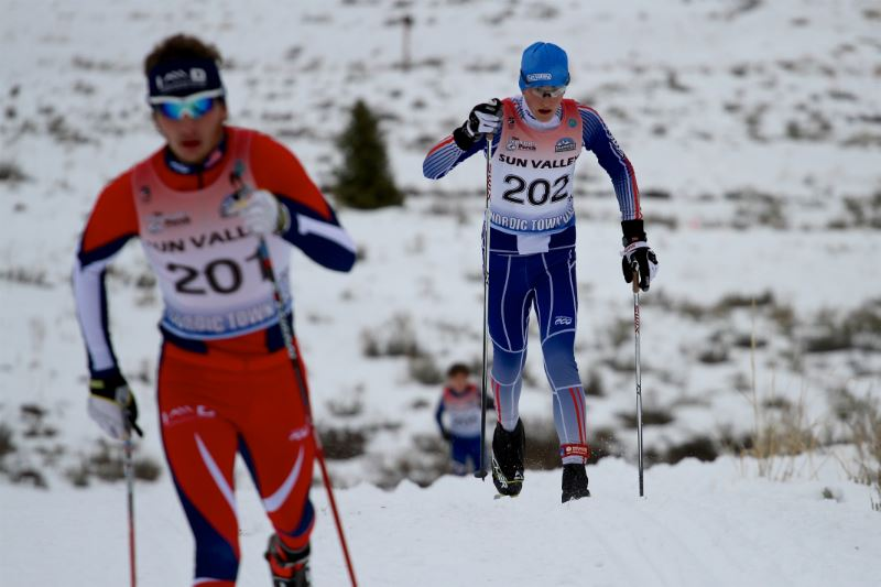 Two cross country skiers on a ski trail