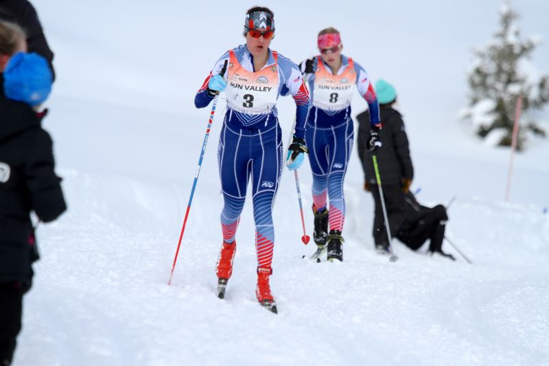 Cross country skiers standing on a snowy mountain