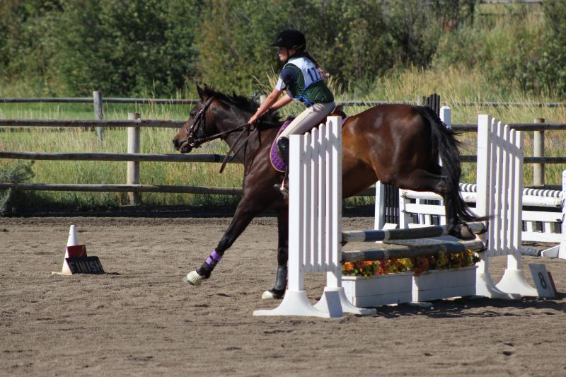 A girl practicing equestrian