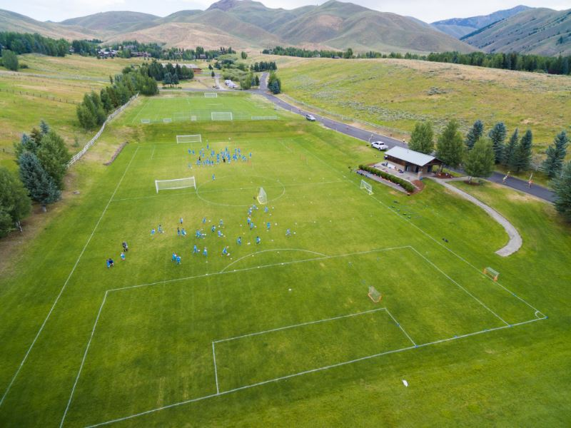 Athletic fields with students practicing