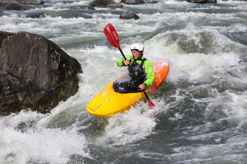A student kayaking in white water