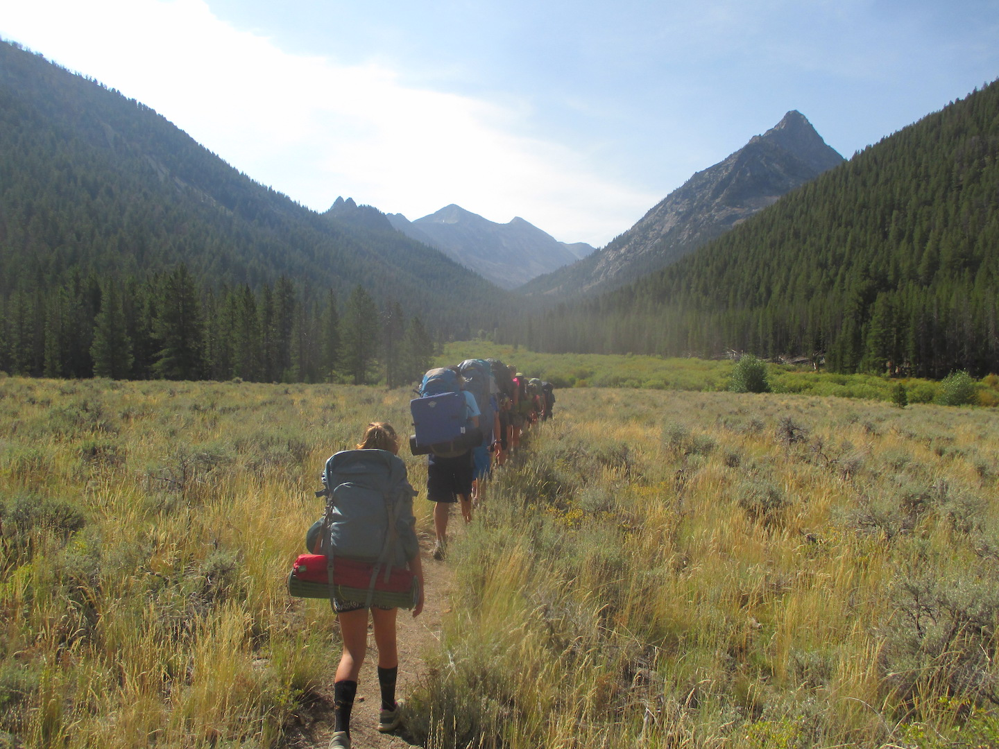A group of students hiking across a field in Sun Valley