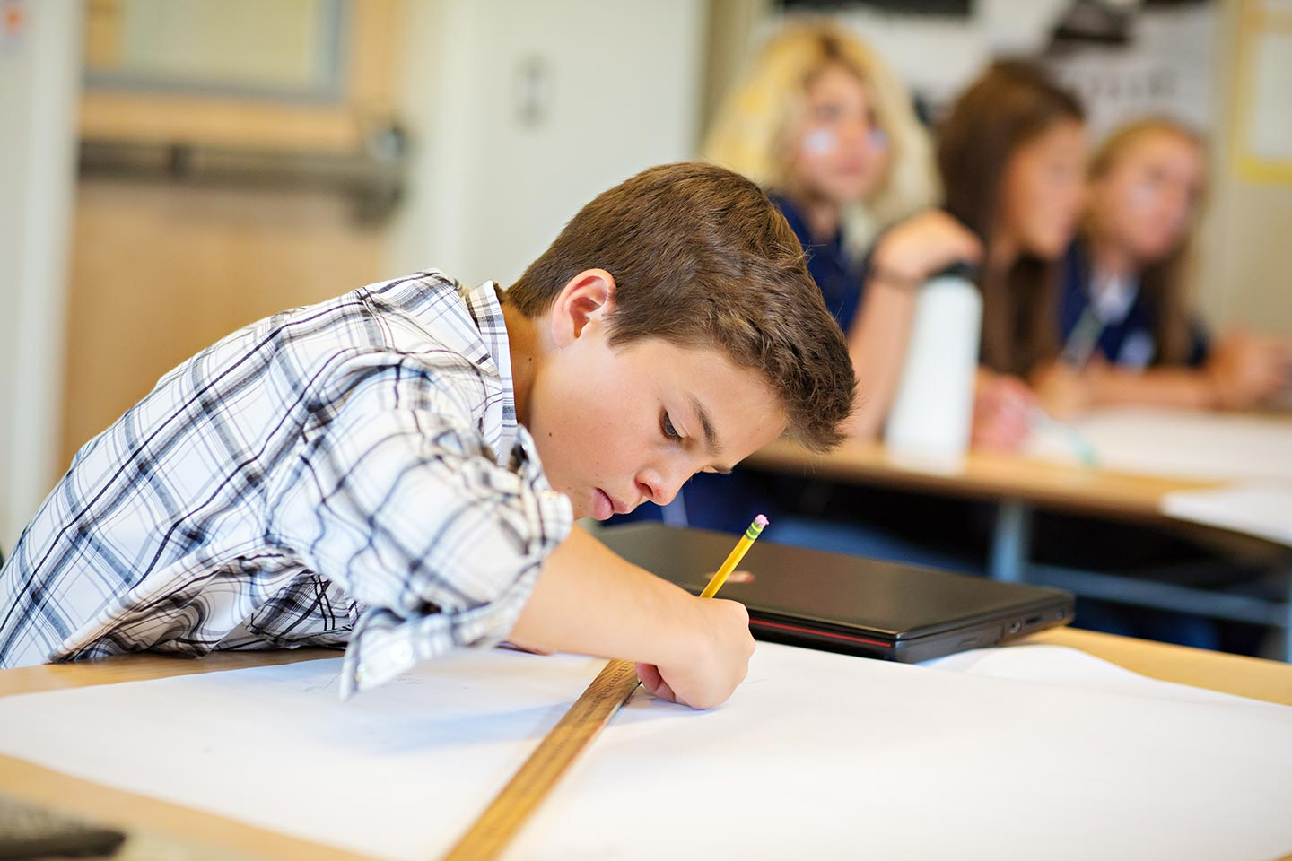 A student working in a classroom at our private day school in Sun Valley, Idaho